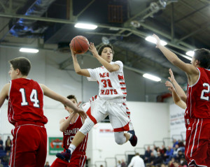 Deandre White of South Portland looks to pass after drawing four Sanford defenders during the fourth quarter. Derek Davis/Staff Photographer