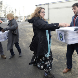 David Boyer, manager of the Campaign to Regulate Marijuana Like Alcohol, passes a box of petitions to Rep. Diane Russell as they prepare for a trip to Augusta to submit them to the Secretary of State's Office.