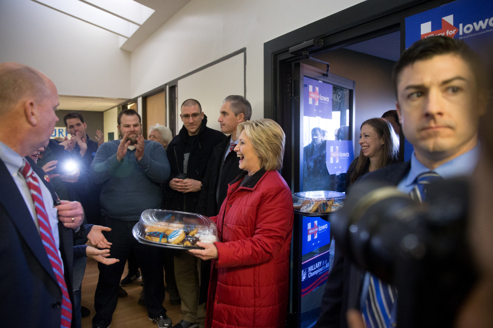 Democratic presidential candidate Hillary Clinton, followed by her daughter Chelsea, arrives to meet with staff at the Hillary for Iowa Office in Des Moines, Iowa, Monday, Feb. 1, 2016.