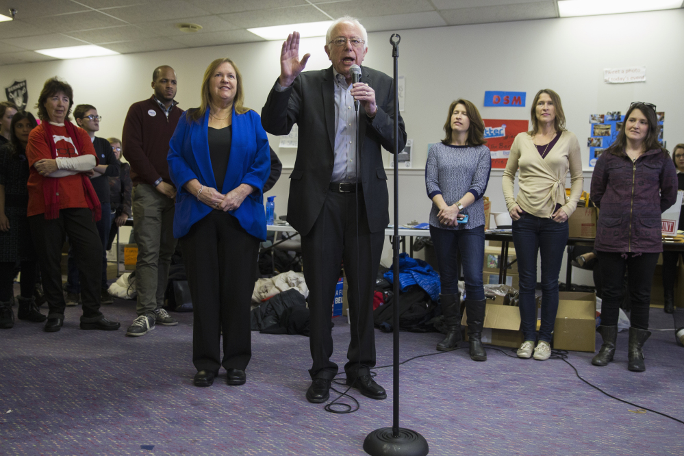Democratic presidential candidate, Sen. Bernie Sanders, I-Vt., accompanied by his wife Jane, visits his campaign headquarters to thank volunteers, Monday, Feb. 1, 2016, in Des Moines, Iowa.