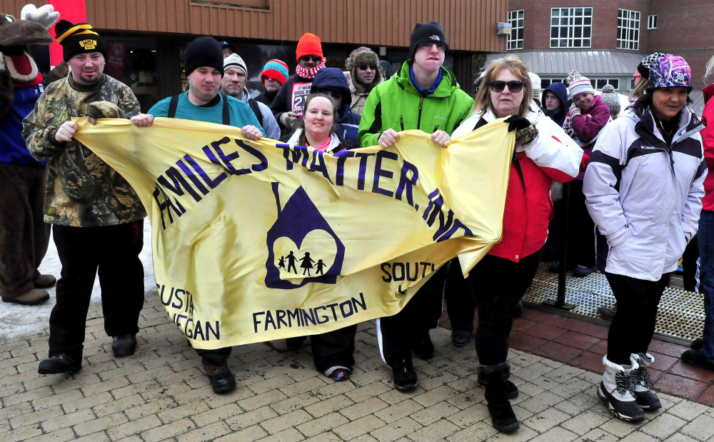 The Families Matter group from Skowhegan and Farmington are cheered as they enter the Parade of Athletes during opening ceremonies of the 2016 Special Olympics Maine Winter Games at Sugarloaf on Monday.