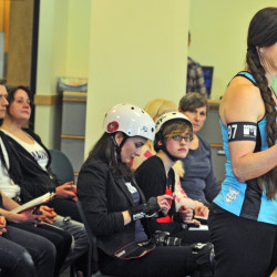 "Christine ""Betty B. Tough"" Blais of Livermore testifies in favor An Act to Encourage Roller Derby during Tuesday's hearing before the Legislature's Labor, Commerce, Research and Economic Development Committee. Several roller derby skaters, some in uniform and gear, testified in favor of the bill sponsored by Rep. Diane Russell, D-Portland."