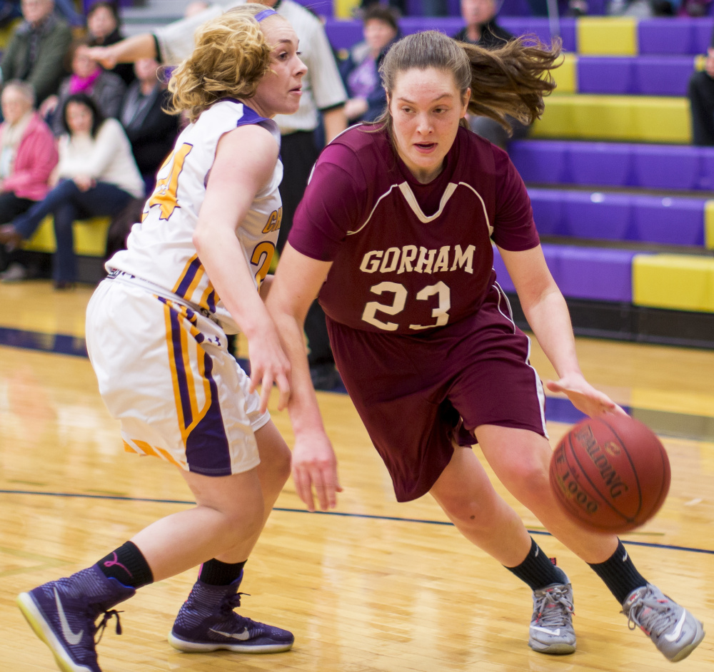 Emily Esposito, who finished with 36 points and six steals, attempts to dribble past Deirdre Sanborn of Cheverus during Gorham's 64-36 victory Tuesday night.