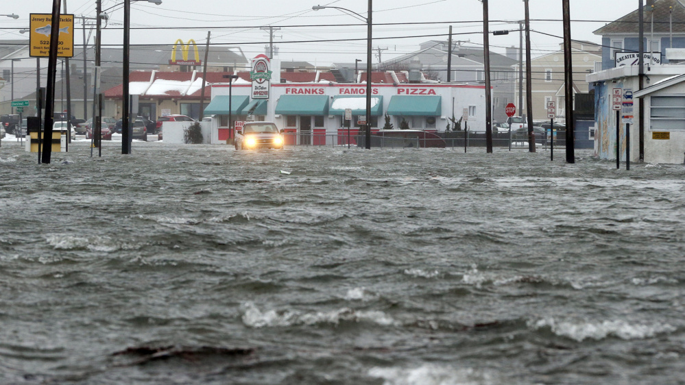 Water floods New Jersey Avenue in North Wildwood, N.J., on Jan. 23, at the height of a winter storm that created near-record high tides along the Jersey Shore.
