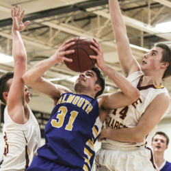Marshall Peterson, left, and Matt Graham of Cape Elizabeth surround Sam Skop of Falmouth as he tries to get a shot off Tuesday night. Falmouth, ranked No. 1 in Class A South, beat the Capers for the second time, 44-42.