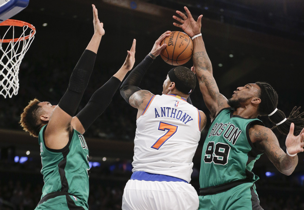Knicks forward Carmelo Anthony is double-teamed by Celtics center Jared Sullinger, left, and forward Jae Crowder during the first quarter Tuesday night in New York.