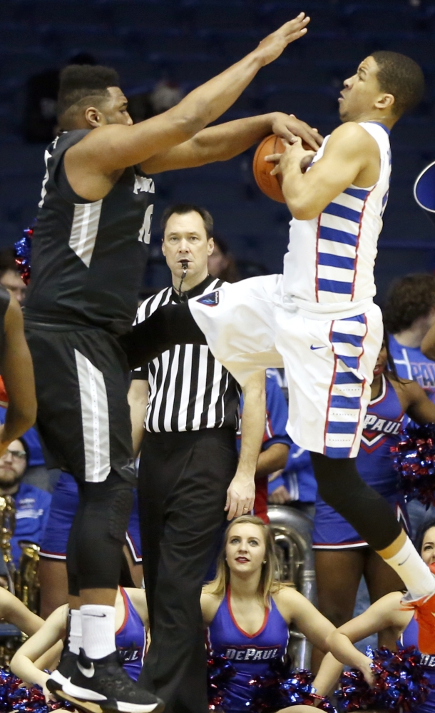 Quadree Smith, left, of Providence strips the ball from DePaul's Billy Garrett Jr. during a 77-70 DePaul win Tuesday at Rosemont, Ill.