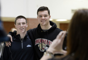 Thornton Academy football players Owen Elliott and Austin McCrum pose for photographs Wednesday after signing National Letters of Intent to play NCAA Division I football. Elliott is going to UMaine and McCrum will attend Lafayette. Shawn Patrick Ouellette/Staff Photographer