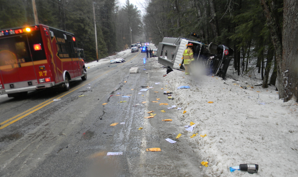 One person was injured when an oil delivery truck rolled over on Route 35 in Naples on Wednesday.