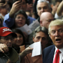 Republican presidential candidate Donald Trump meets with attendees during a campaign stop Tuesday in Milford, N.H. (AP Photo/Matt Rourke)