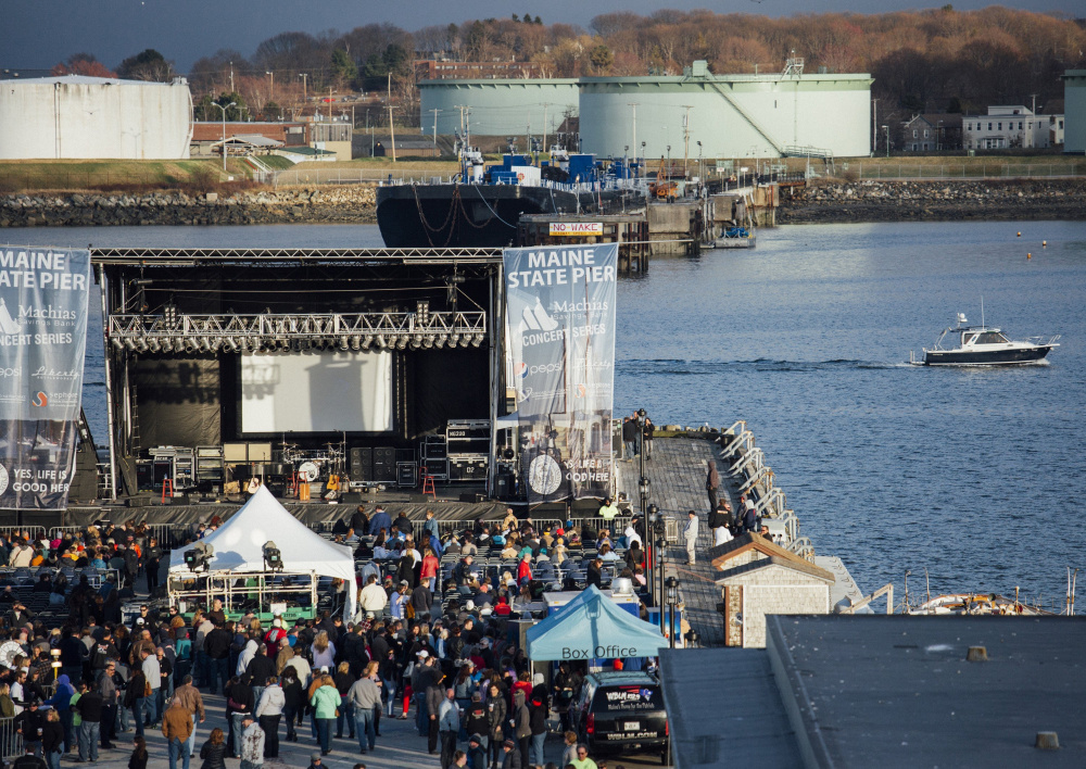 Crowds gather on the Maine State Pier last May for a Pat Benatar concert. The pier hosted 27 shows last year and the promoter is now working on this year's lineup, along with looking into covering the pier to reduce noise.