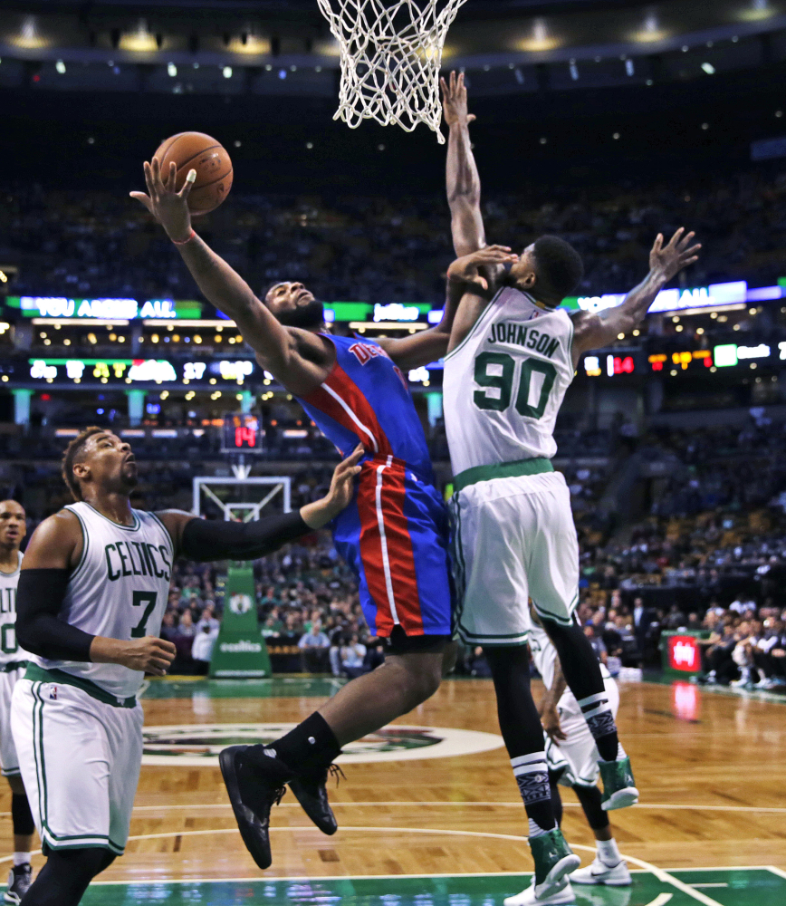 Johnson tries to block Detroit Pistons center Andre Drummond on a drive to the basket during the first quarter.