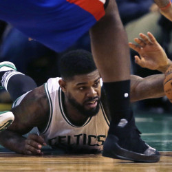 Boston Celtics forward Amir Johnson (90) dives for a loose ball during the second quarter of an NBA basketball game against the Detroit Pistons in Boston on Wednesday. Photos by The Associated Press