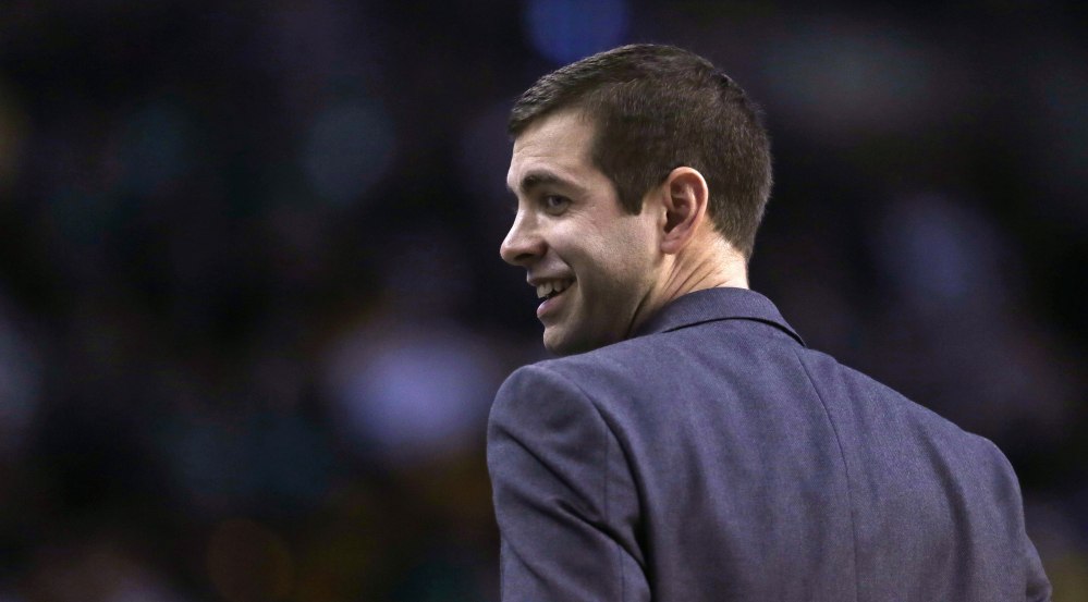 Boston Celtics head coach Brad Stevens smiles as he heads back to the bench during the first quarter.