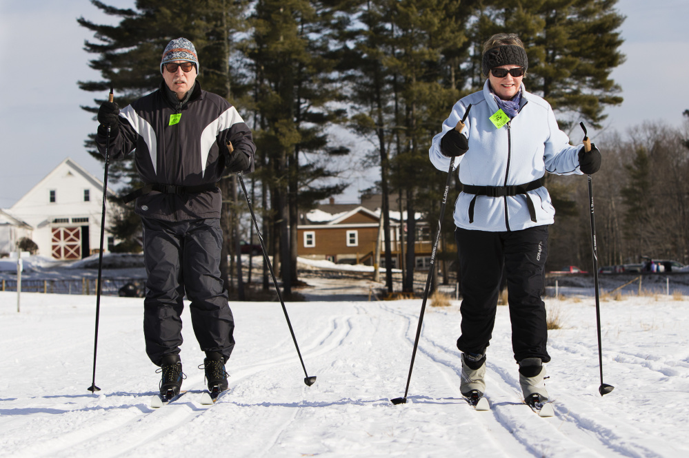 Rich and Jane Lisauskas of Kennebunk cross-country ski along the Buzzell Trail at Harris Farm in Dayton on Jan. 26.