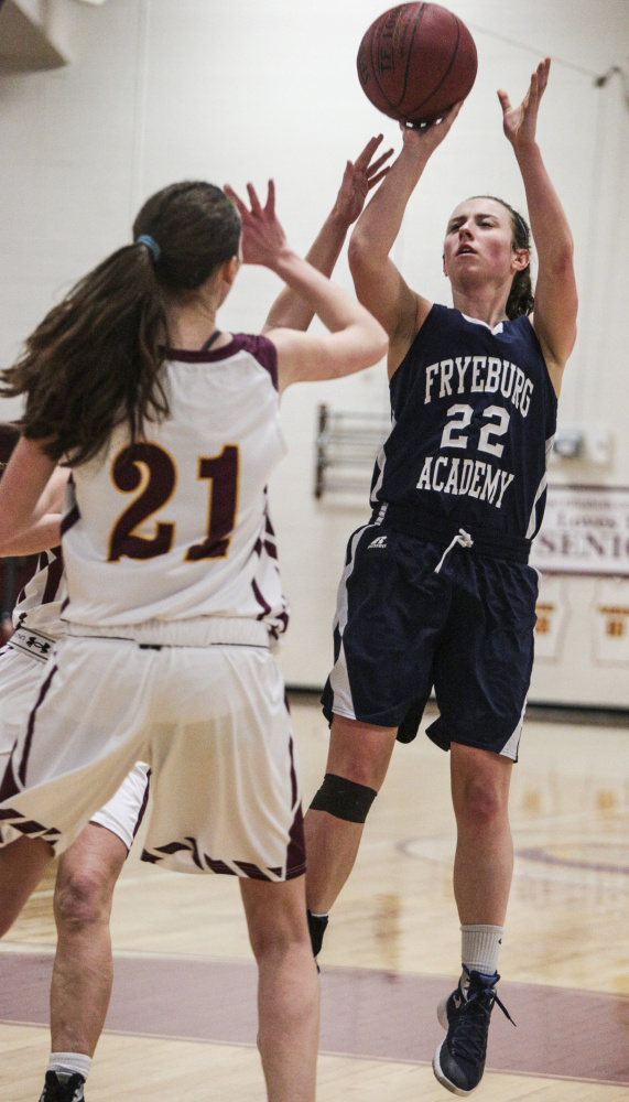 Fryeburg Academy guard Julia Quinn lands a basket while Cape Elizabeth Sammi Guerette defends at Cape Elizabeth High School in Cape Elizabeth, ME on Thursday. Whitney Hayward/Staff Photographer