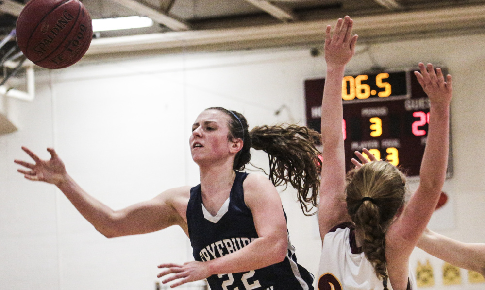 Fryeburg Academy guard Julia Quinn collides with Cape Elizabeth's Kelly O'Sullivan while attempting to shoot Thursday in a Class A South season finale. Fryeburg won, 40-27.