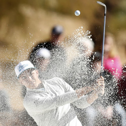 Rickie Fowler blasts out of trap during the first round of the Phoenix Open on Thursday at Scottsdale, Arizona. A frosty morning led to play being suspended with Fowler, Shane Lowry and Hideki Matsuyama sharing the lead for the day.