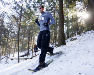 It's all downhill for Shawn Walker as he traverses a trail in the woods during a 5-kilometer race at Lost Valley Ski Area in Auburn on Jan. 30.