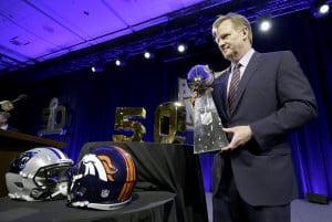 NFL Commissioner Roger Goodell poses with the Lombardi Trophy after his annual state-of-the-game news conference Friday in San Francisco.