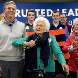 Barbara Bush jokes with her son, Republican presidential candidate, former Florida Gov. Jeb Bush, while introducing him at a town hall meeting in Derry, N.H., on Thursday.