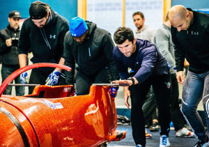 Frank Del Duca, second from right, trains with the U.S. bobsled team in Park City, Utah.