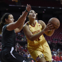 Maryland's Brionna Jones drives to the basket Friday night against Jasmine Hines of Michigan State. Jones had 17 points and 17 rebounds in an 85-76 victory.