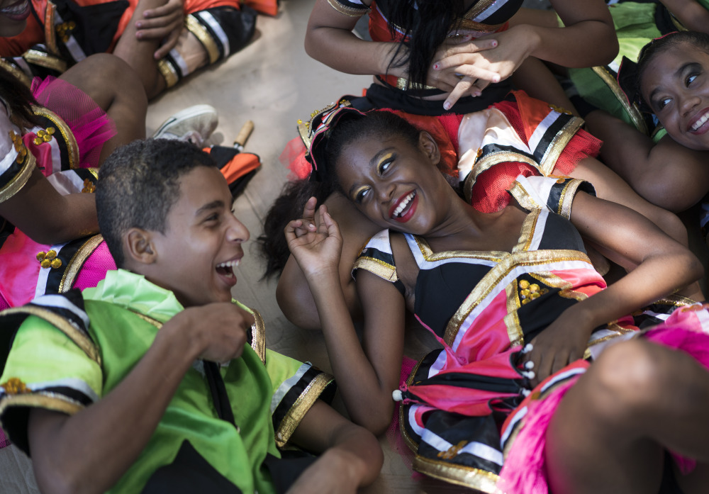 Young revelers joke with each other as they lay in the shade during a carnival event in Brazil. Scientists said Friday that they found the presence of Zika virus in saliva and urine samples, which means the disease could be spread by more than just mosquitoes.