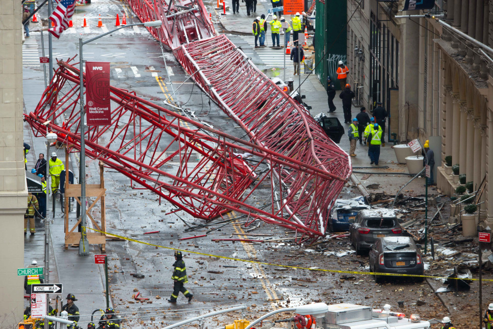 A collapsed crane fills the street on Friday in New York. The huge construction crane was being lowered to safety in a snow squall when it plummeted onto the street in the Tribeca neighborhood of lower Manhattan.