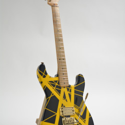 This undated photo provided by Guernsey's auction house shows a yellow-and-black Charvel guitar, customized for Eddie Van Halen in the 1980s It could bring $60,000 to $80,000 when it goes up for sale on Feb. 27 in New York.