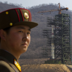 A North Korean soldier stands in front of the rocket launching site in Tongchang-ri.