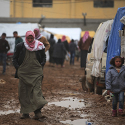 Although Turkey is providing aid to thousands of displaced Syrians, such as these near the Bab al-Salam border crossing in Syria, it has yet to open its gates to more refugees.