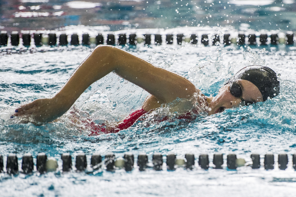Freshman Olivia Tighe of Cape Elizabeth takes a breath while on her way to winning the 200-yard freestyle. Tighe was named the top performer of the meet while leading the Capers to the team title. Only Cape Elizabeth and Greely have won the championship since 2008.