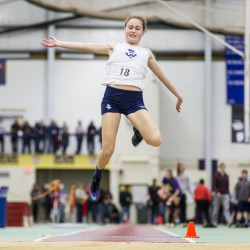 Kelsey Cavanaugh of Westbrook soars toward the long jump pit Saturday during the SMAA indoor track and field championships at the University of Southern Maine. Cavanaugh placed second with a jump of 15-1 .