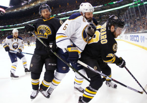 Buffalo's Mike Weber, center, gets caught between Boston's Max Talbot, left, and Landon Ferraro during the second period of the Bruins' 2-1 overtime win Saturday in Boston.