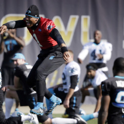 Carolina Panthers quarterback Cam Newton (1) jokes with teammates during practice in preparation for Super Bowl 50, Friday in San Jose, Calif.