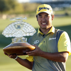 Hideki Matsuyama holds the trophy after winning the Phoenix Open golf tournament, Sunday, Feb. 7, 2016, in Scottsdale, Ariz. (AP Photo/Rick Scuteri)