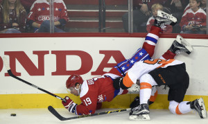 Washington Capitals center Nicklas Backstrom, left, is upended during a battle for the puck against Philadelphia Flyers center Nick Cousins during the third period of a 3-2 win by the Capitals on Sunday afternoon at Washington.