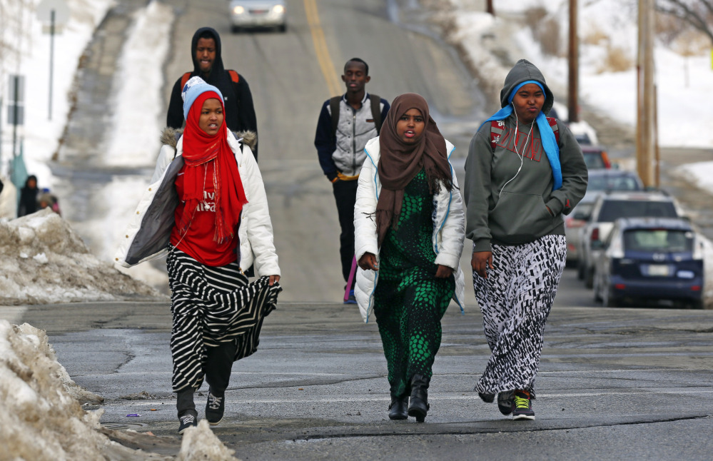 Students walk home from school in Lewiston. Since February 2000, more than 5,000 Africans have come to Lewiston, a city of 36,500. Fifteen years later, though, Somali shops, restaurants and mosques serve as an example of how far the city of Lewiston has come.