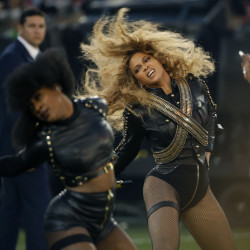 The Associated Press In this Sunday, Feb. 7, 2016 file photo, Beyonce performs during halftime of the NFL Super Bowl 50 football game in Santa Clara, Calif. Beyonce is working overtime this weekend: After releasing a new song Saturday and performing at the Super Bowl on Sunday, she's announced a new stadium tour. The Grammy-winning singer announced her 2016 Formation World Tour in a commercial after she performed at the halftime show with Bruno Mars and Coldplay.