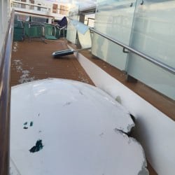 Royal Caribbean's ship Anthem of the Seas shows signs of damage after being hit by large waves while sailing toward Fort Lauderdale, Fla., on Sunday.