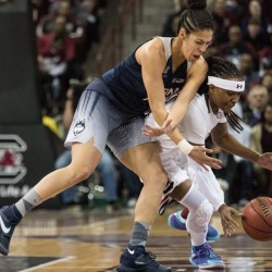 South Carolina's Khadijah Sessions, right, battles Connecticut's Kia Nurse for a loose ball during the first half of the Huskies' 66-54 win Monday at Columbia, South Carolina.