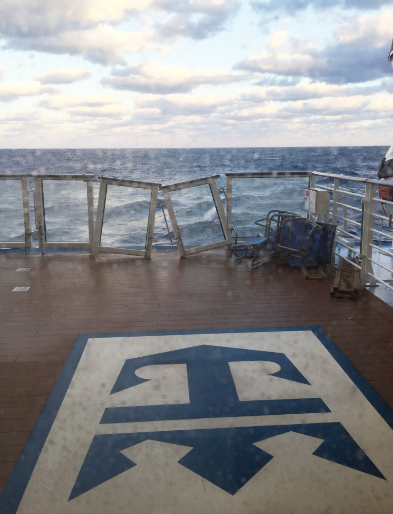 The deck of Royal Caribbean's ship Anthem of the Seas was damaged when the ship ran into high winds and rough seas in the Atlantic Ocean on Sunday, forcing passengers into their cabins overnight. No injuries were reported and only minor damage to some public areas.
