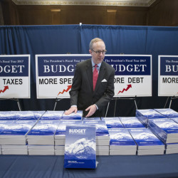 Copies of President Barack Obama's final fiscal 2017 federal budget proposal are staged for display by Eric Euland, Republican staff director for the Senate Budget Committee, Tuesday on Capitol Hill.