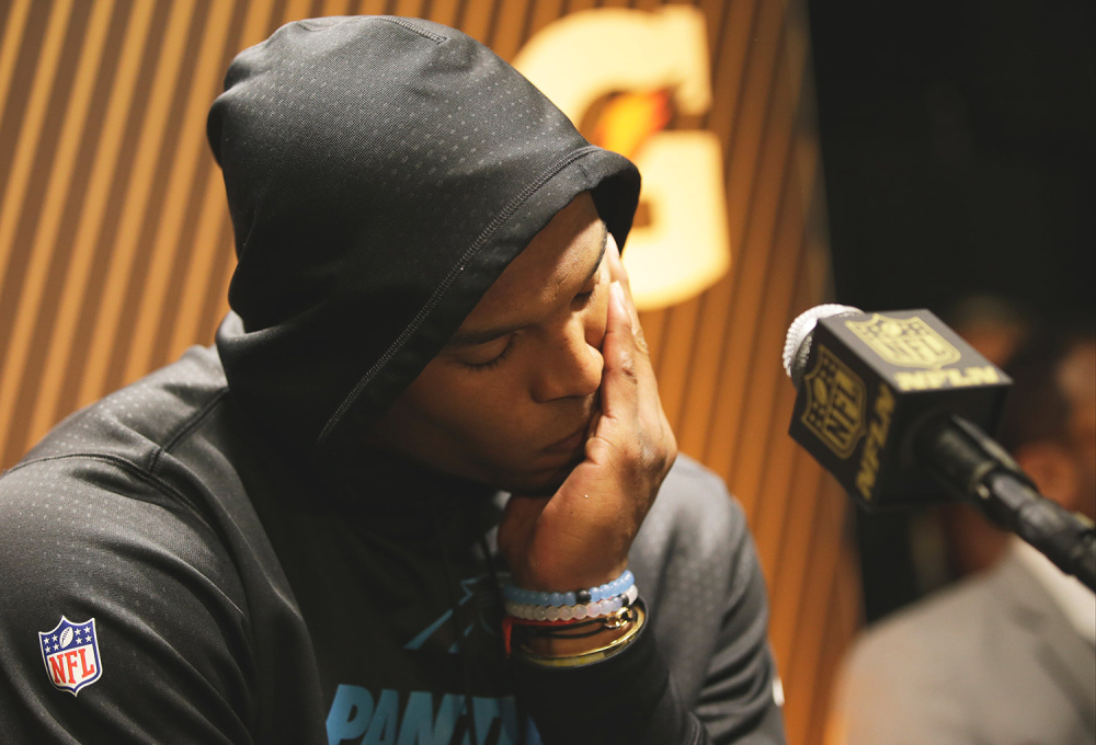 Carolina Panthers' Cam Newton answers questions after his team's Super Bowl loss against the Denver Broncos on Sunday. He said Tuesday that he doesn't plan to change how he reacts to loss just to appease critics.