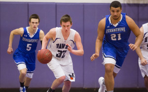 Marshwood and Kennebunk players chase a loose ball during their game Tuesday night.