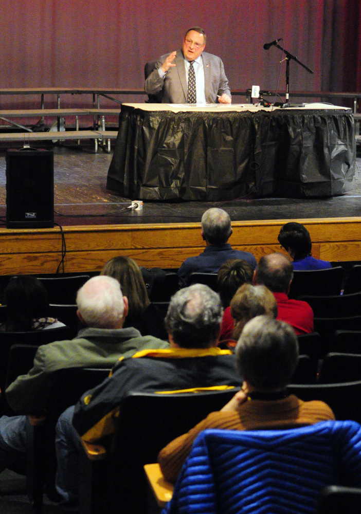 Gov. Paul LePage speaks during a town hall-style meeting Tuesday evening at Hall-Dale High School in Farmingdale.