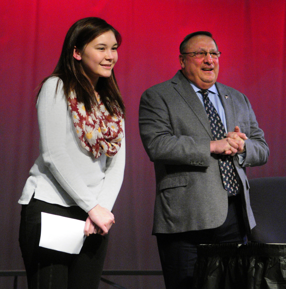 Cassie DiBenedetti, left, introduces Gov. Paul LePage before his town hall-style meeting Tuesday at Hall-Dale High School in Farmingdale.