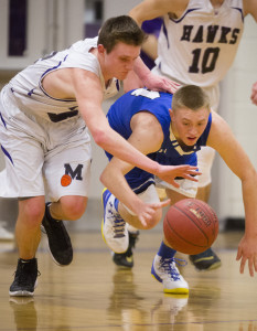 Ben Beers of Marshwood and Kennebunk freshman Cameron Lovejoy compete for a loose ball Monday night. Marshwood won and will meet top-ranked Greely in the quarterfinals Friday night at the Portland Expo.