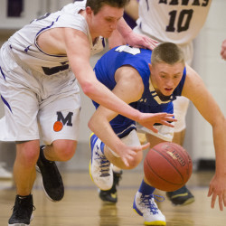 Ben Beers of Marshwood and Kennebunk freshman Cameron Lovejoy compete for a loose ball Monday night. Marshwood won and will meet top-ranked Greely in the quarterfinals Friday night at the Portland Expo.  Carl D. Walsh/Staff Photographer